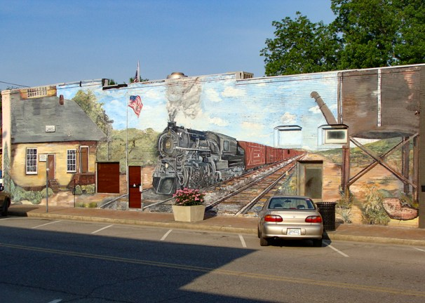 A mural of the old train depot graces the wall of a building in downtown Leeds, Jefferson County, celebrating the city's railroad history. (From Encyclopedia of Alabama, photograph by Lamar Jones, Anniston)