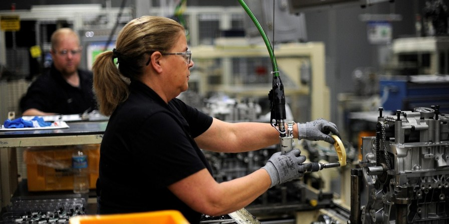 A Hyundai employee works on the engine line in Montgomery. (contributed)