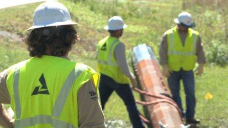 Scott Shultz's line crew works a job for Alabama Power. (Joe Allen/Alabama NewsCenter)
