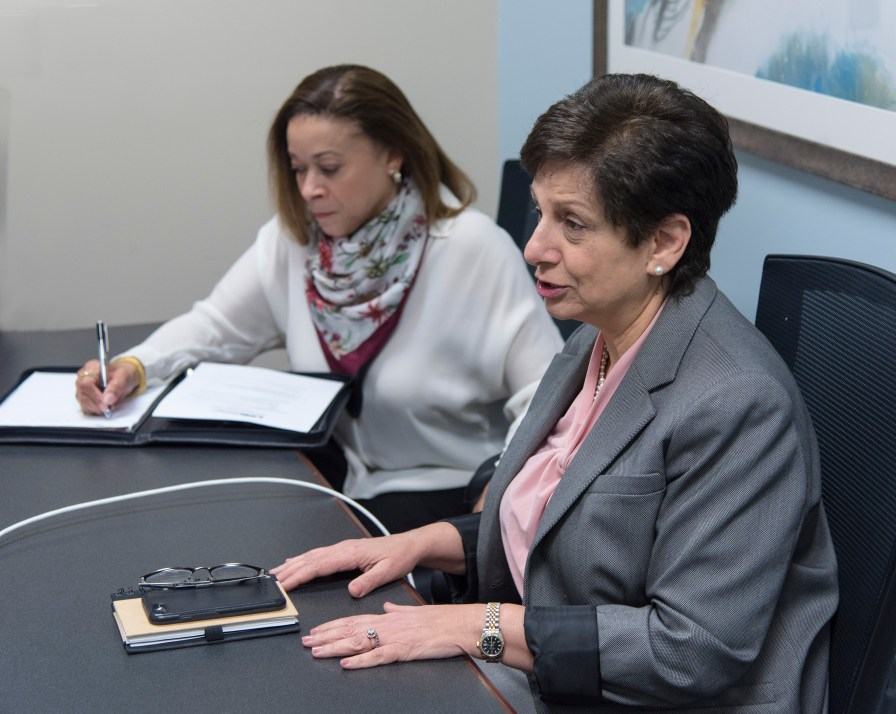 Dr. Mona Fouad, right, senior associate dean for Diversity and Inclusion, meets with her staff, including Evelyn Jones, administrative director, UAB School of Medicine. (Bernard Troncale)