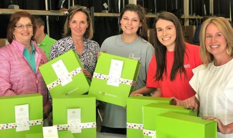 Volunteers from Alabama Power Service Organization, Regions, Greystone Golf and Country Club and Edgar's Bakery teamed with Cheeriodicals to pack and deliver gift boxes to mothers and children at Children's of Alabama on Mother's Day. (Dennis Washington / Alabama NewsCenter)