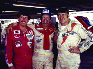 Racecar driver Neil Bonnett, left, poses with fellow Alabama Gang members Bobby, right, and Donnie Allison. The Alabama Gang, centered in Hueytown, was a successful group of NASCAR drivers during the 1970s and 1980s. (From Encyclopedia of Alabama, courtesy of the Alabama Sports Hall of Fame)