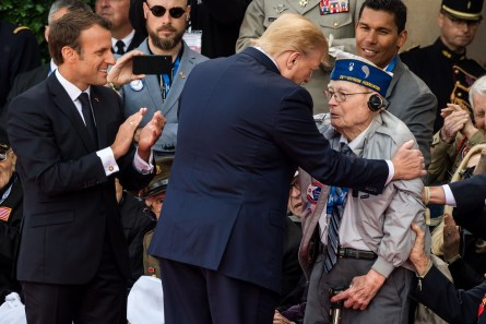 Emmanuel Macron, France's president, left, and U.S. President Donald Trump, meet World War II veterans during a ceremony at the Normandy American Cemetery and Memorial in Colleville-sur-Mer, France, on Thursday, June 6, 2019, the 75th anniversary of theD-Daylandings. (Geert Vanden Wijngaert/Bloomberg)