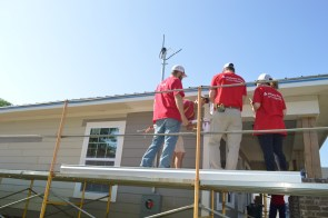 Members of the Alabama Power Service Organization work on a home for the Edwards family in Tuscaloosa. (Danielle Kimbrough)