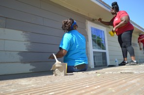 Volunteers paint the future Edwards home under construction by Habitat for Humanity. (Danielle Kimbrough)