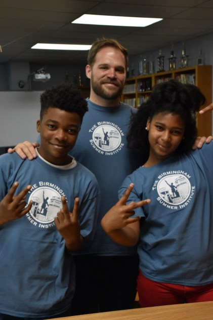 Taylor Eads, shown with Birmingham Summer Institute students Darrious Moore and Dyimen Sylve, says running BSI is his favorite job ever. (Dury Shamsi-Basha/Alabama NewsCenter)
