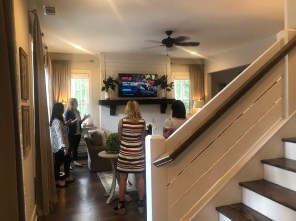 Members of the Auburn and Opelika Chambers of Commerce get a look at the first Northwoods smart home. (contributed)
