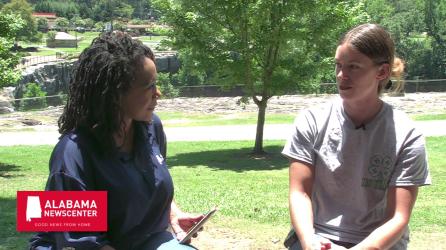 Keisa Sharpe-Jefferson talks with Amber Bennett, owner of Forgotten Ways Farm. (Dennis Washington/Alabama NewsCenter)