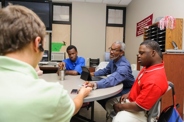 Dr. John Myrick, affiliate instructor for CrossingPoints, works with Tier 1 students on campus. (University of Alabama)