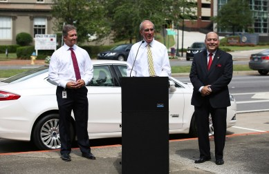 Mayor Sandy Stimpson, center, comments during an unveiling ceremony for newly installed electric vehicle charging stations Monday, July 15 in downtown Mobile. The project is a partnership between Alabama Power and the City of Mobile. Looking on are Nick Sellers, Alabama Power Mobile Division vice president, left, and Joe Snowden, Waterfront Coordinator with the City of Mobile. (Mike Kittrell)