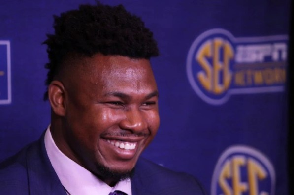 Prince Tega Wanogho smiles during questioning from reporters at SEC Media Days in Hoover. (Bruce Nix / Alabama NewsCenter)