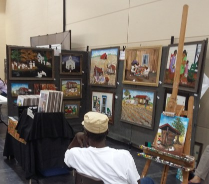 Maurice Cook of Birmingham is a famous Southern folk artist who demonstrates his painting techniques of traditional scenes. (Mack Gothard)