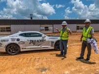 Gary Merriman of Hoar Construction gives media a tour of the construction work at the Talladega Superspeedway on July 10, 2019. (Dennis Washington / Alabama NewsCenter)