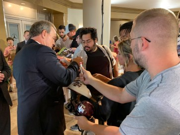 Texas A&M coach Jimbo Fisher signs autographs and greets fans at SEC Media Days 2019. (Dennis Washington / Alabama NewsCenter)