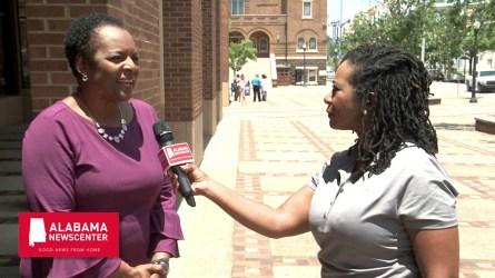 Denise Gilmore speaks with Keisa Sharpe-Jefferson outside the Birmingham Civil Rights Institute. (Dennis Washington / Alabama NewsCenter)