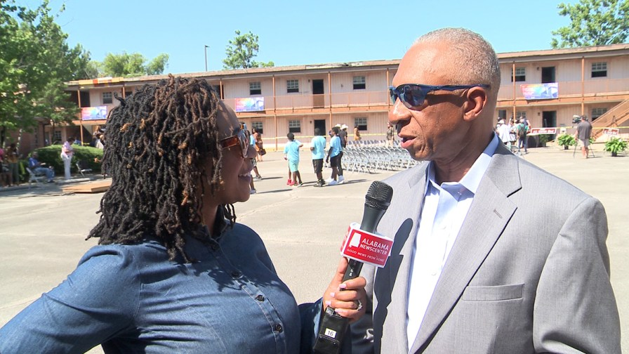 Bob Dickerson speaks with Keisa Sharpe-Jefferson at the site of the historic A.G. Gaston Motel. (Dennis Washington / Alabama NewsCenter)