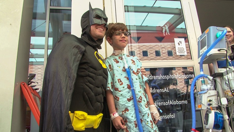 Batman poses for a picture with a patient outside Children's of Alabama. (Dennis Washington / Alabama NewsCenter)