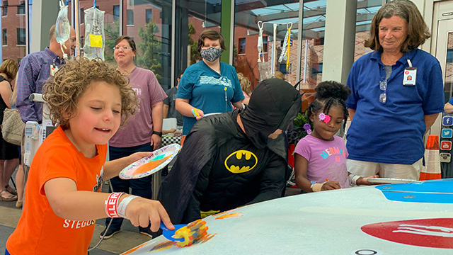 Children's of Alabama patients paint car from Talladega Superspeedway