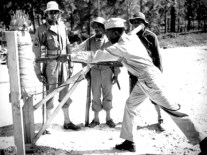 Lt. B Holmes, an officer of the 92nd Infantry Division demonstrates the use of a bayonet at Fort McClellan in Calhoun County in this photo from November 1942. The 92nd was a segregated division composed entirely of African American men and was only the second such unit in the U.S. Army at the time. (From Encyclopedia of Alabama, National Archives and Records Administration)