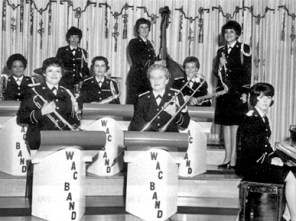 Fort McClellan, located in Anniston, was the home of the Women's Army Corps (WAC) School as well as a museum honoring the Corps. Here, members of the dance band unit of the 14th Army Band (WAC) perform at an event at the WAC Center at the fort in 1965. (From Encyclopedia of Alabama, courtesy of Jacksonville State University)