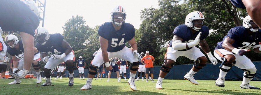 The Auburn offensive line practices. (Todd Van Emst/AU Athletics)