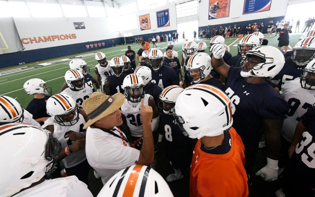 Auburn coach Gus Malzahn talks to his team to start the first practice of the season on Aug. 2. (Todd Van Emst/AU Athletics)
