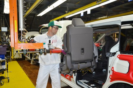 An employee at Honda's facility in Lincoln assembles a Honda Odyssey. (contributed)