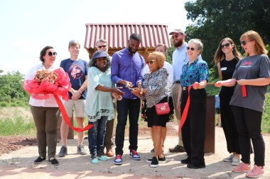 Birmingham Mayor Randall Woodfin cuts the ribbon on the extension of High Ore Line Trail. (Freshwater Land Trust)