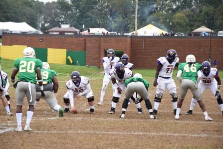 Quarterback Daniel Smith (1) prepares to take a snap from center Aaron Scroggins. (Miles College Athletics)
