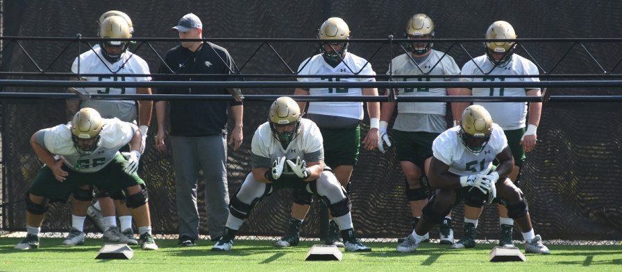 UAB offensive linemen go through drills in football camp. (Solomon Crenshaw Jr./Alabama NewsCenter)