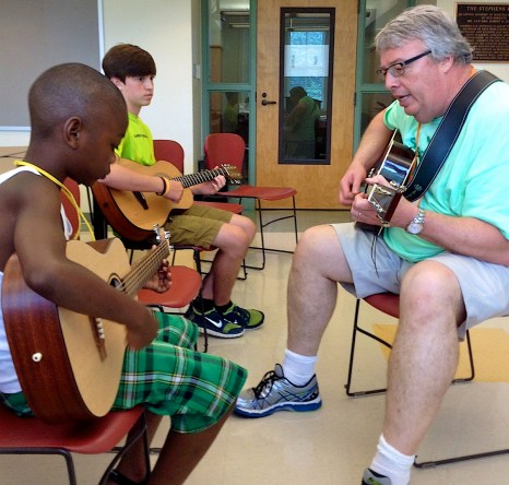 Vestavia Hills Baptist Church pastor Gary Furr plays the guitar during Sowing Seeds of Hope's Summer Seed Camp. (CBF Alabama)