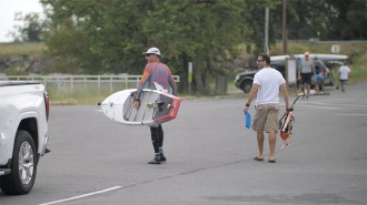 One of the contestants carries his paddle board to the start of the Great Alabama 650. (Dennis Washington / Alabama NewsCenter)