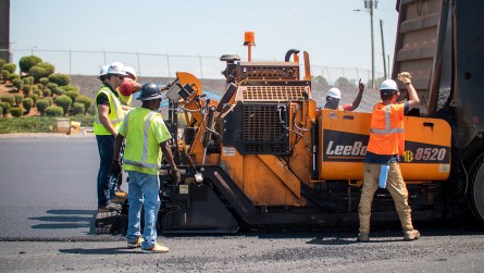 Construction workers pave a parking lot at Talladega Superspeedway. (Dennis Washington / Alabama NewsCenter)