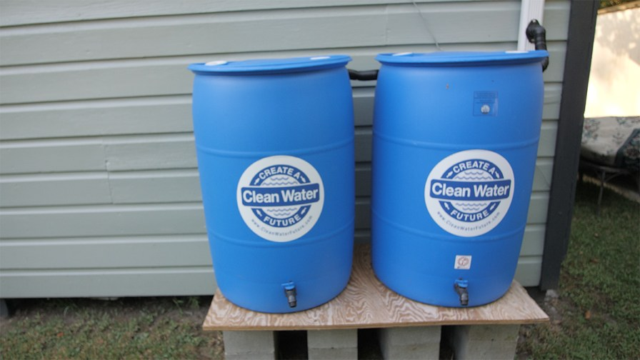 The two rain barrels are connected, giving the homeowner up to 110 gallons of water to use for watering plants, grass and washing cars. (Dennis Washington / Alabama NewsCenter)