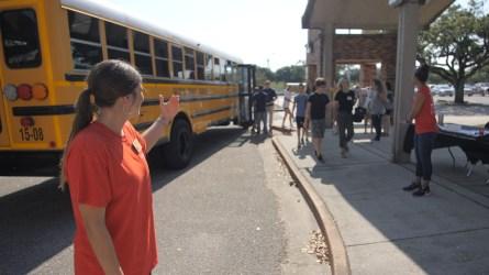 A volunteer helps direct students. (Dennis Washington / Alabama NewsCenter)