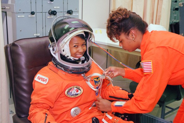 On Sept. 12, 1992, launch day of the STS-47 Spacelab-J mission on space shuttle Endeavour, NASA astronaut Mae Jemison waits as her suit technician, Sharon McDougle, performs an unpressurized and pressurized leak check on her spacesuit at the Operations and Checkout Building at Kennedy Space Center. (Image credit: NASA)