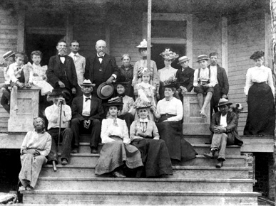 Founder Capt. Jefferson M. Falkner (back row, holding straw hat) poses with Confederate veterans and family members on the steps of the unfinished first cottage of the Soldiers' Home in May 1902. (From Encyclopedia of Alabama, courtesy of Confederate Memorial Park)