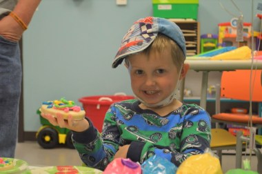 Daniel Logan Allen has fun with arts and crafts at Smile-A-Mile. (contributed)