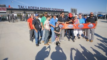 NASCAR driver Joey Logano and Talladega Superspeedway President Brian Chrichton cut the ribbon Friday on the new Talladega Garage Experience. (Dennis Washington / Alabama NewsCenter)