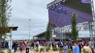 Fans enjoy the race from the courtyard of the new Talladega Garage Experience. (Dennis Washington / Alabama NewsCenter)