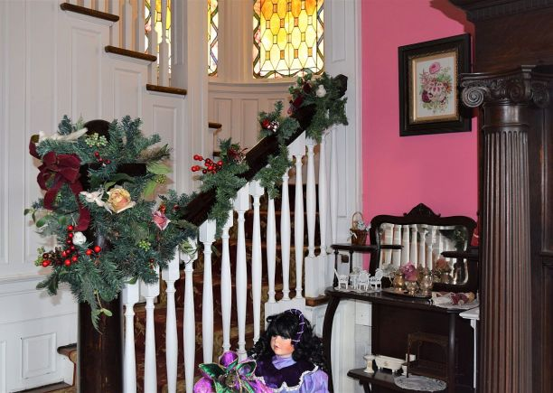 Garland and red berries decorate stairways. (Donna Cope/Alabama NewsCenter)