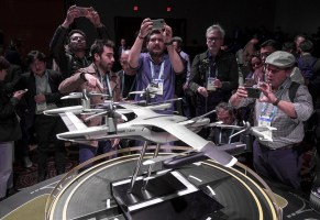 Members of the media photograph a model of Hyundais aerial taxi during a press event at CES 2020 event in Las Vegas. (David Paul Morris/Bloomberg)