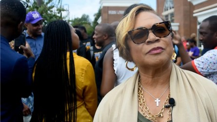 Then-interim President Bobbie Knight attends a September pep rally at Miles College, at which Charles Barkley, in background, addressed the students. Barkley later announced a $1 million donation to the school. (Solomon Crenshaw Jr./Alabama NewsCenter)