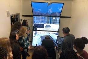 Students try out a crane simulator at Southeast Worlds of Work in Dothan. (Brooke Goff/Alabama NewsCenter)