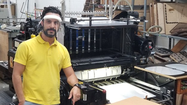 Michael Cuesta of Calagaz Printing wears a face mask the Mobile printing company is making for health care workers. (contributed)