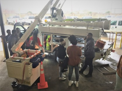 Students examine a bucket truck at Alabama Power's Career Day. (Chuck Chandler/Alabama NewsCenter)