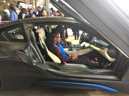 Students check out an electric BMW i8 sports car at Alabama Power's Career Day. (Chuck Chandler/Alabama NewsCenter)