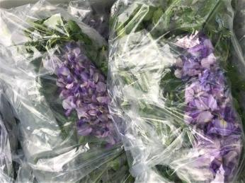 Salad mix with flowers for sale at the Irondale Farm Stand. (Bradleigh Turnipseed Pfitzer)