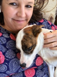 Jeannine Bailey with Lindsey, the mixed-breed puppy she recently adopted from Crossing Paths Animal Rescue Center in Blount County. (Jeannine Bailey)