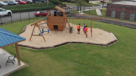 Children play together on a playground at Presbyterian Home for Children in Talladega before the COVID-19 pandemic began. Forced isolation from one another has been difficult for the children. (contributed)